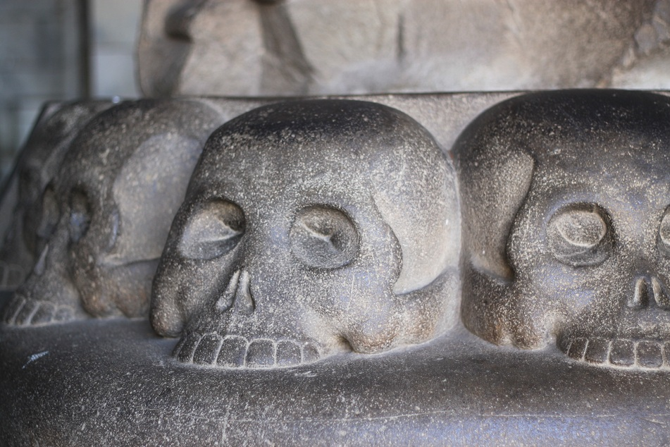 Skull Carvings at the Bottom of the Statue of King Adityavarman