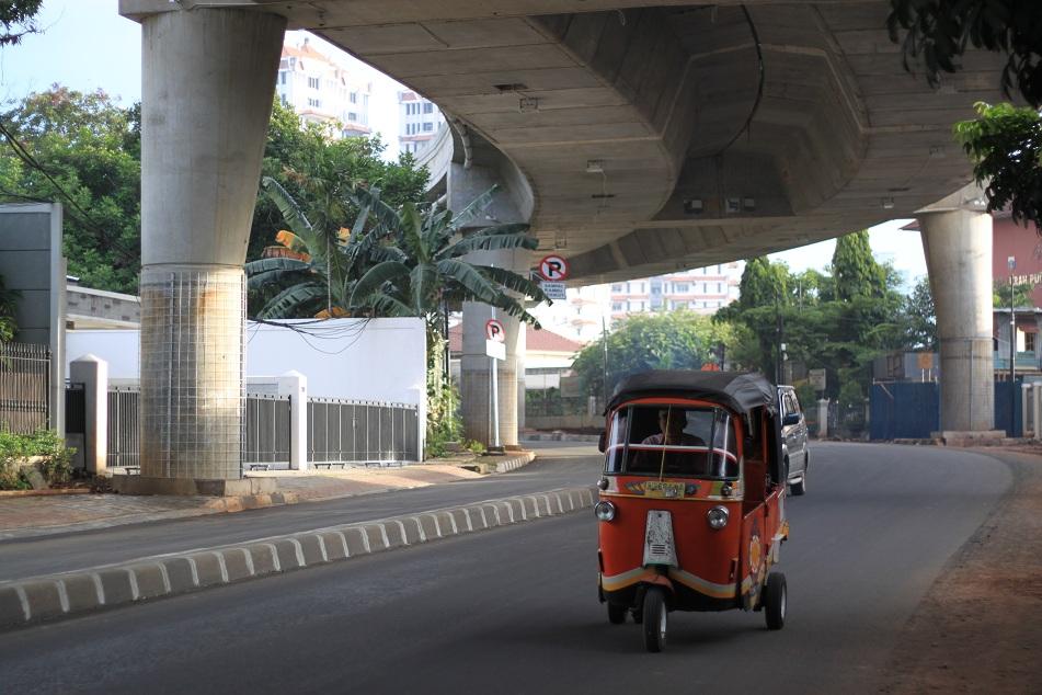 A Bajaj under A Newly-Built Flyover