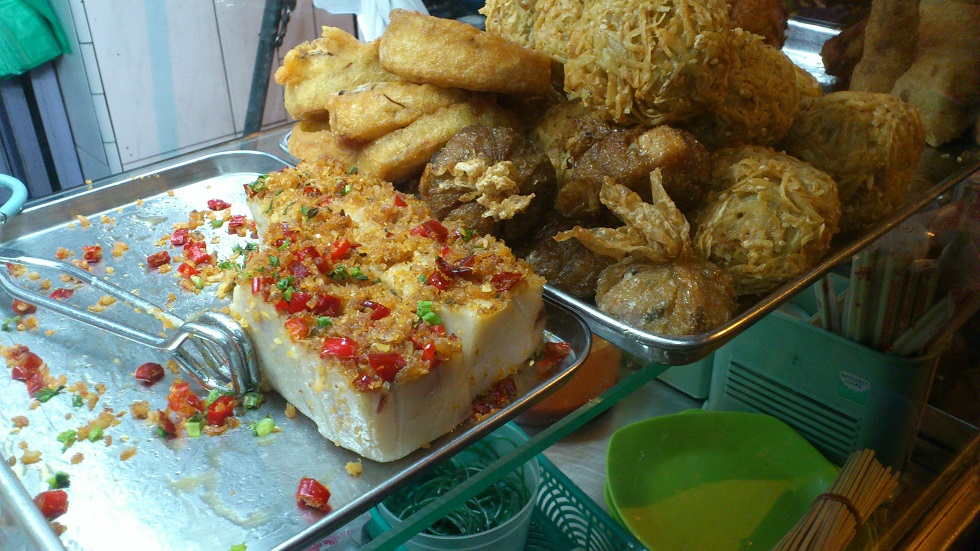 Kue Keladi (Savory Taro Cake) Served with Dried Shrimps, Fried Garlic, and Red Chili