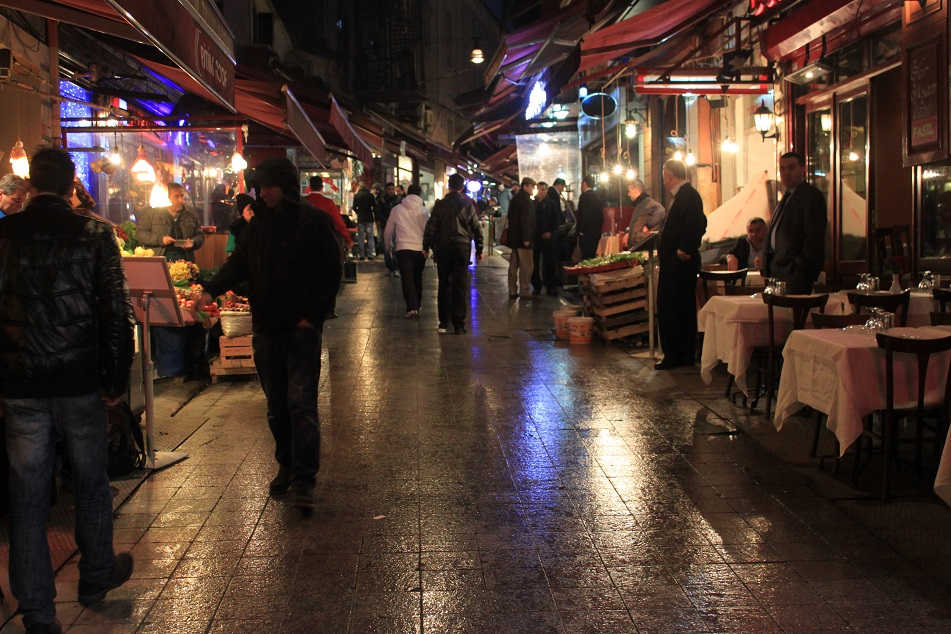 An Alley Dotted with Open-Air Restaurants and Fresh Produce Vendors