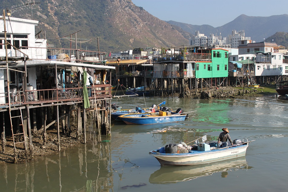 A Local Fisherman Navigating Tai O's Waterways