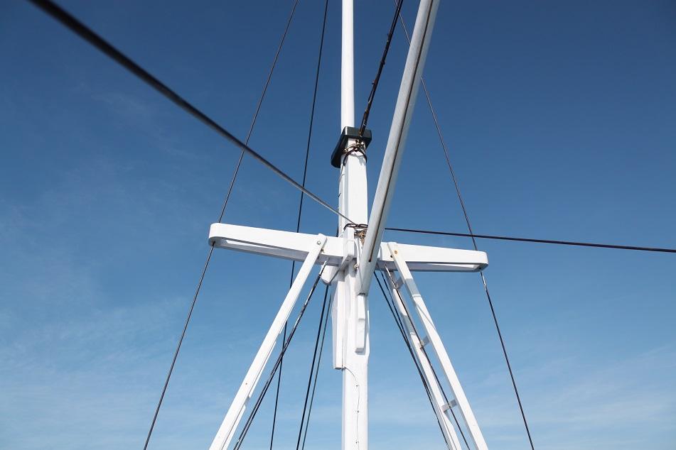 Behind the Bright White Mast