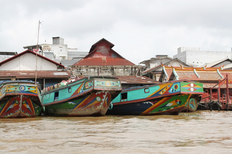 Colorful Boats along the Musi River