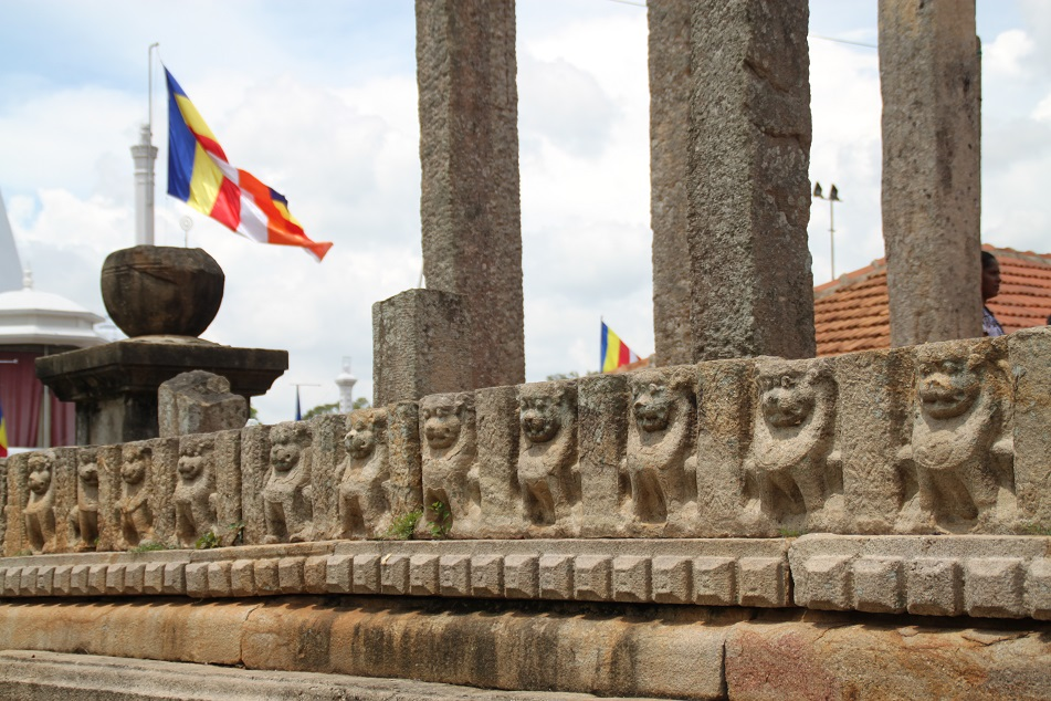 Animal Carvings and Theravada Buddhism Flags at Ruwanwelisaya