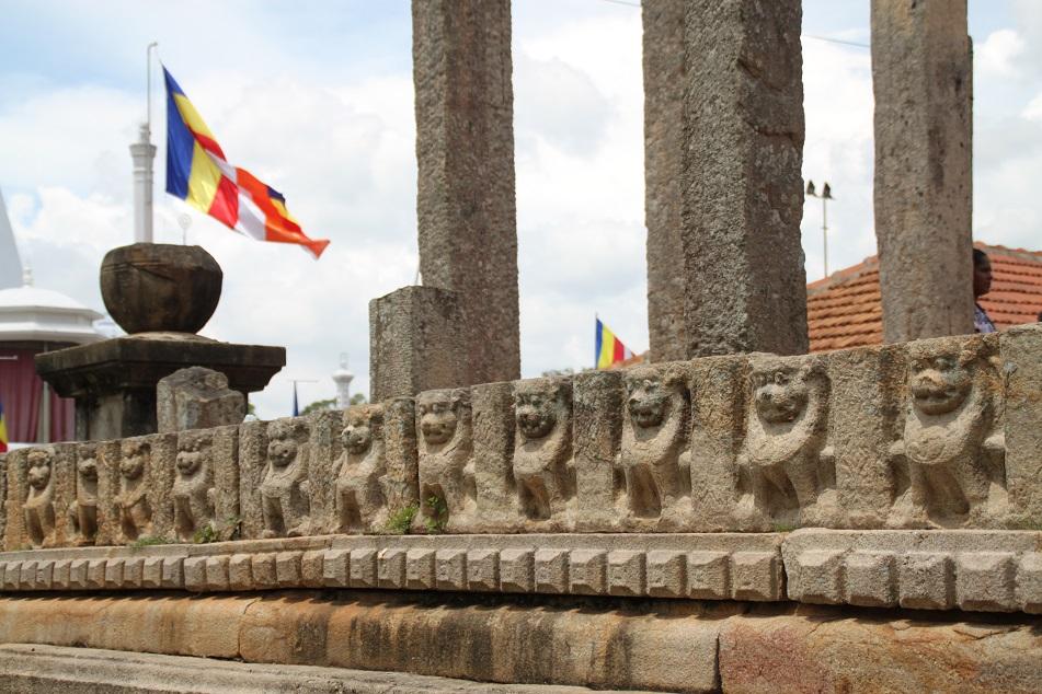 Animal Carvings and Theravada Buddhism Flags at Ruwanwelisaya