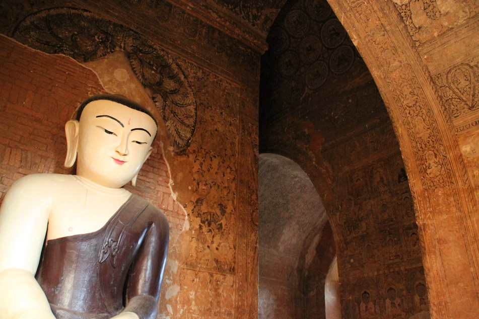 The Buddha in An Ornately Painted Chamber