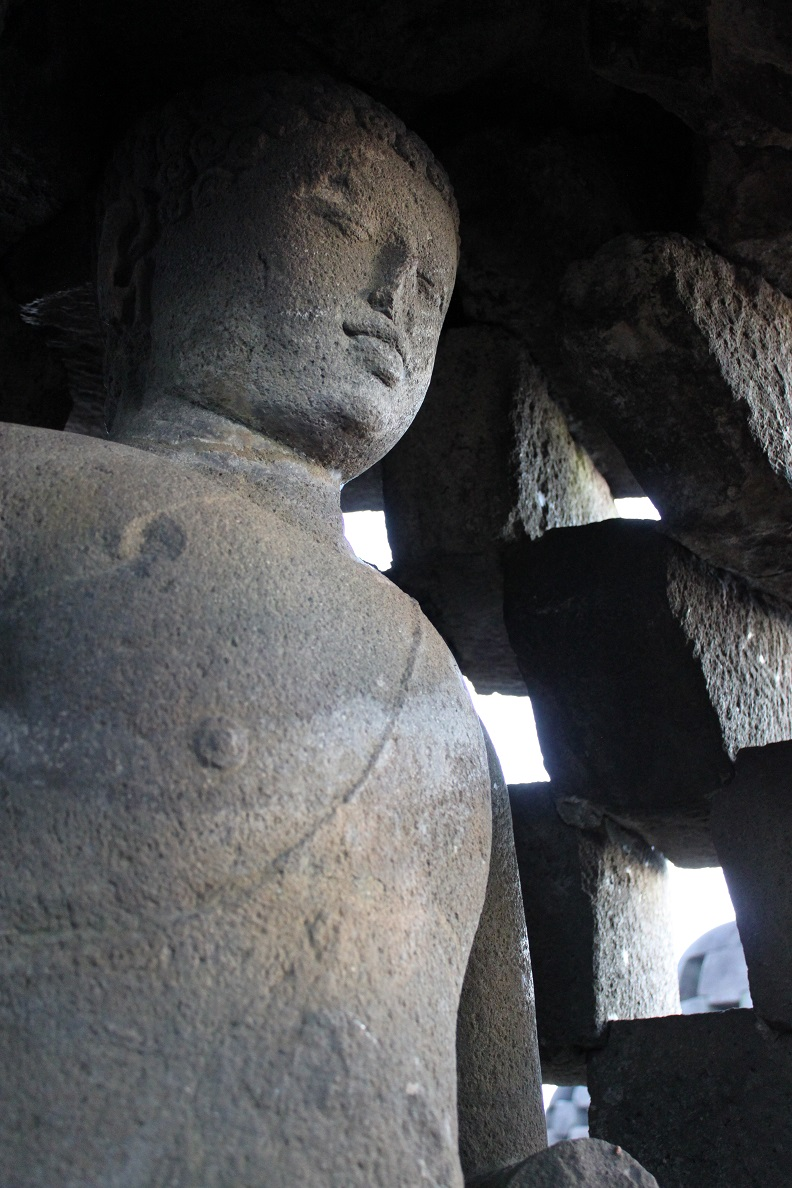 A Buddha Statue inside A Stupa