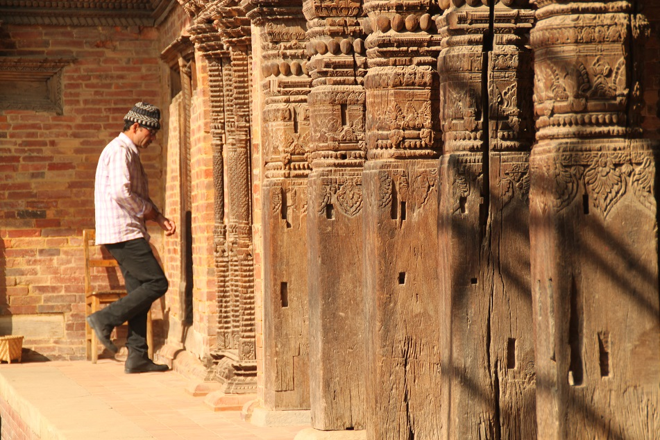 Walking through Ancient Wooden Pillars
