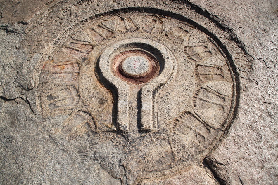 Symbols of Shiva Carved on A Rock