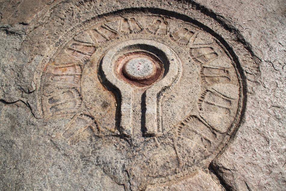 Symbols of Shiva Carved on A Rock