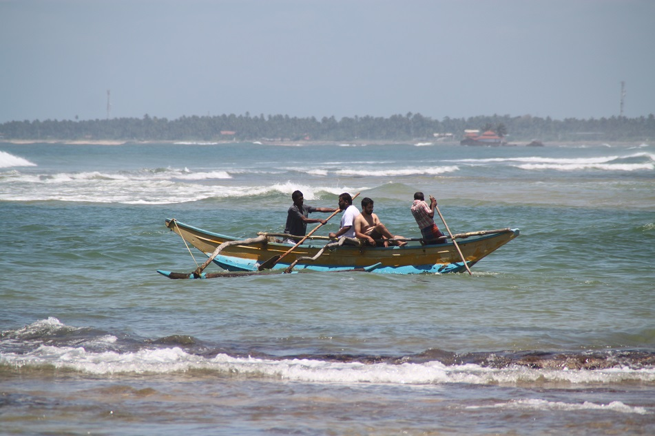 Men on A Traditional Boat Going Against the Big Waves