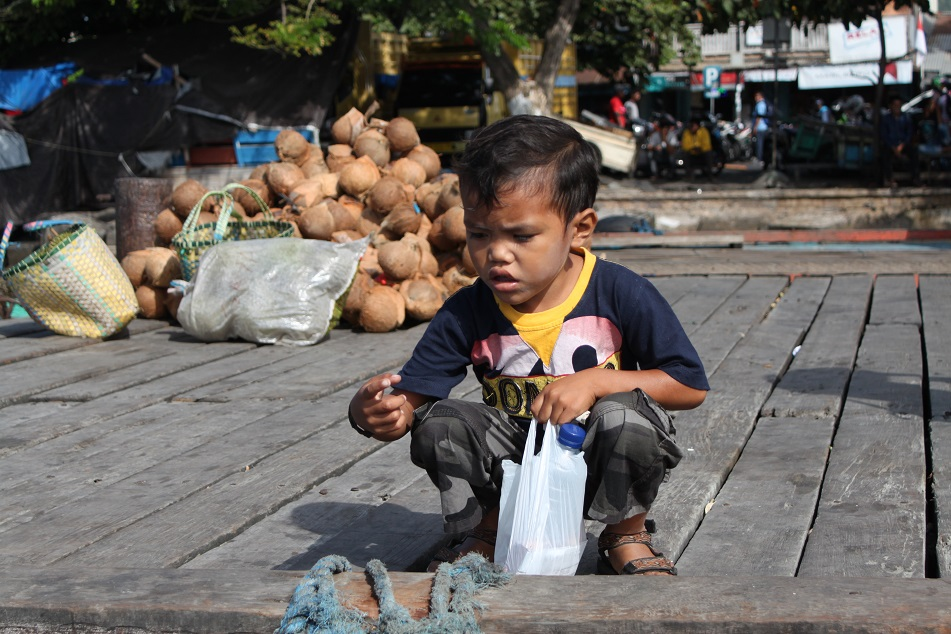 A Boy Waiting for the Boat to Cross to Tidore