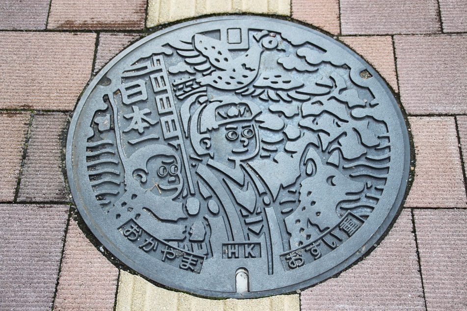 Okayama's Manhole Cover, Depicting Momotaro (A Character of A Japanese Folklore)