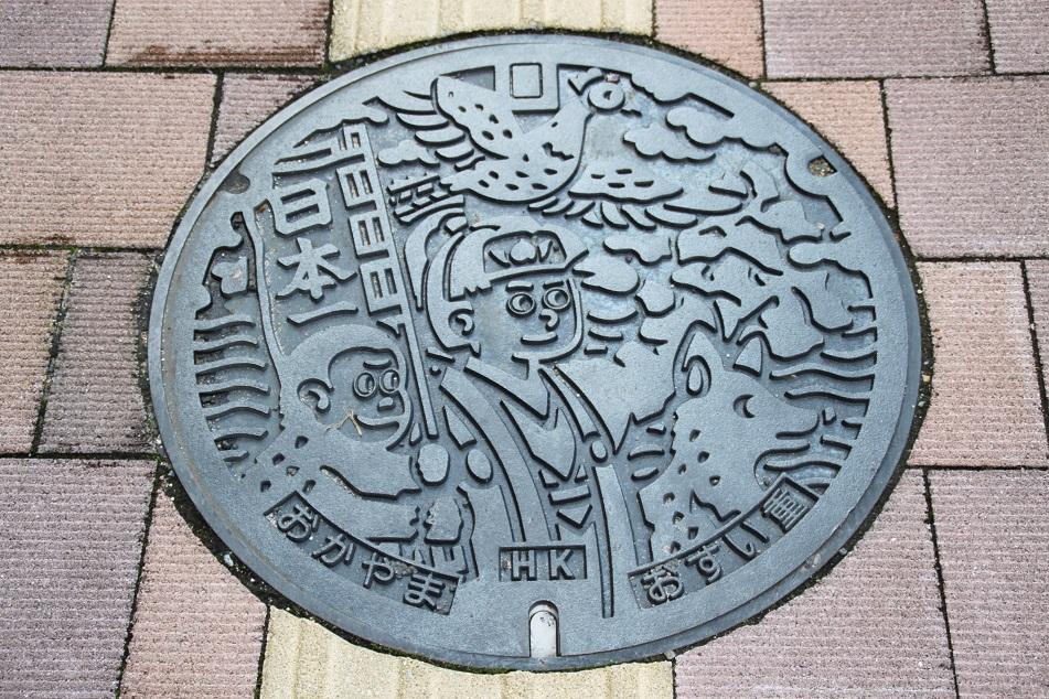 Okayama's Manhole Cover, Depicting Momotaro (A Character of A Japanese Folklore)